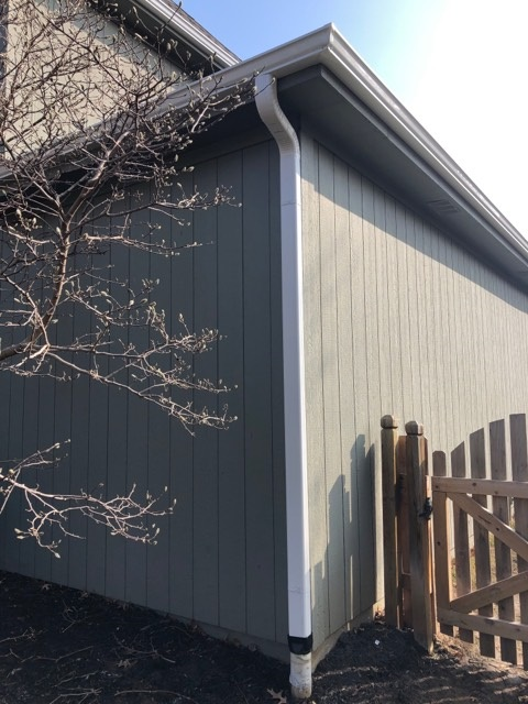 Buck Roofing-Kansas and Missouri-Residential-Gutter Installation-Gutter Images-White Gutters-Downspout