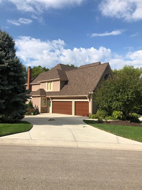 Buck Roofing installed a new roof on this house in the Kansas City area