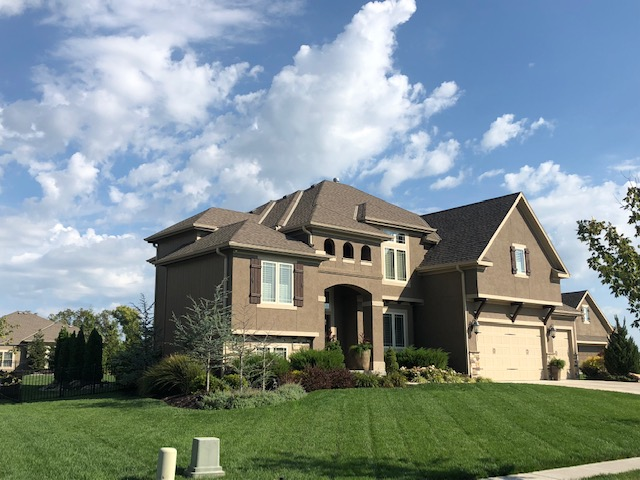 This large house has a brand new roof installed by the experts in roof installation in Kansas City, Buck Roofing