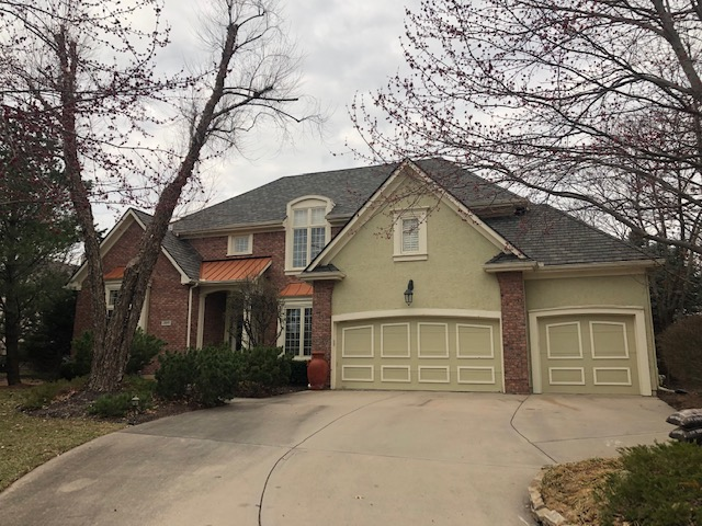 Buck Roofing provides residential roof installation like the rood on this house in Kansas City