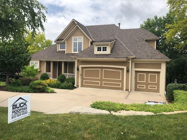 Beige house with a roof from Buck Roofing, residential roof installers in the Kansas City area