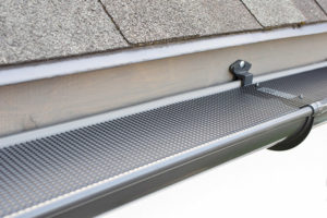 Gutter with a gutter cover installed by Buck Roofing in Kansas City