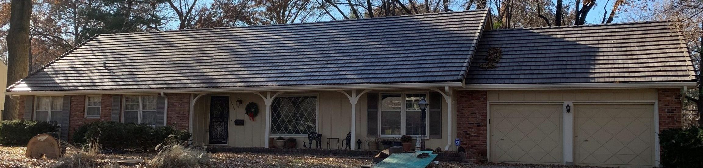 Residential roof replacement on a Kansas City house by Buck Roofing